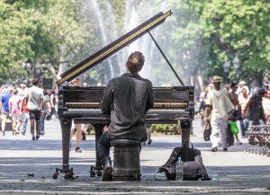 man playing piano in manhattan